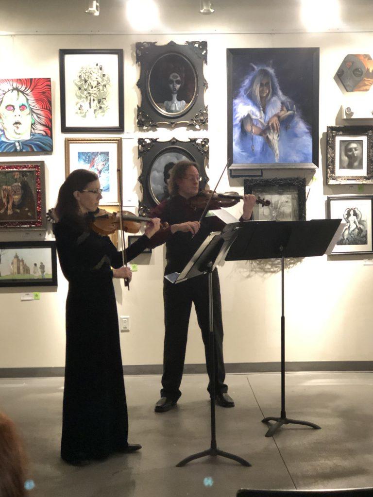 Catherine & Joe performing in an art gallery